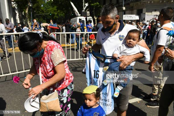 Fans mourn in the queue line to pay tribute to Diego Maradona on November 26 2020 in Buenos Aires Argentina Maradona died of a heart attack at his...
