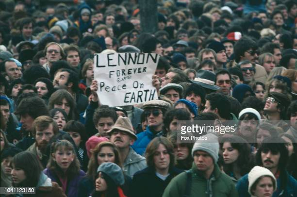 Fans mourn musician John Lennon, formerly of the Beatles, with a banner reading 'Lennon Forever - Peace on Earth', December 1980. Lennon was shot and...
