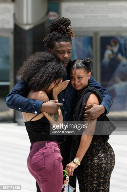 Fans mourn outside the XXXTentacion Funeral Fan Memorial at BBT Center on June 27 2018 in Sunrise Florida