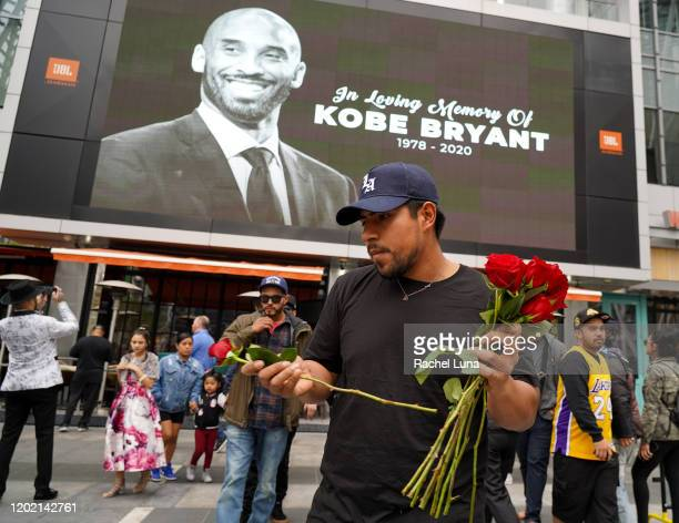 A fans mourns the death of retired NBA star Kobe Bryant outside the Staples Center prior to the 62nd Annual Grammy Awards on January 26 2020 in Los...