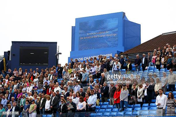 Fans observe a minutes silence for the victims of the Orlando shootings ahead of the start of play during day one of the Aegon Championships at the...