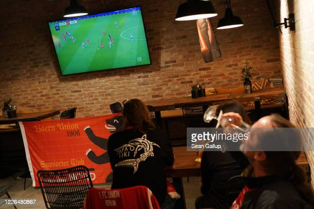 Fans of 1 FC Union football club sit at Loretta an der Spreee sports bar to watch their team play against Berlin rival Hertha BSC during the...