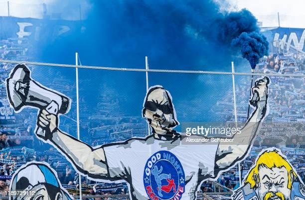 Fans of 1860 Muenchen burn flares during the 3. Liga match between TSV 1860 Muenchen and Bayern Muenchen II at Stadion an der Gruenwalder Straße on...