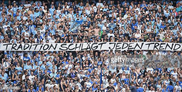 Fans of 1860 Muenchen hold up a banner during the Second Bundesliga match between TSV 1860 Muenchen and RB Leipzig at Allianz Arena on August 10 2014...