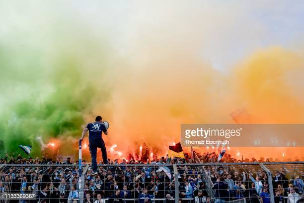 Fans of 1860 Muenchen start pyrotechnics during the 3. Liga match between TSV 1860 Muenchen and F.C. Hansa Rostock at Stadion an der Gruenwalder...