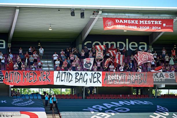 Fans of AaB Aalborg at the stands prior to the Danish 3F Superliga match between AaB Aalborg and FC Midtjylland at Aalborg Portland Park on June 14,...