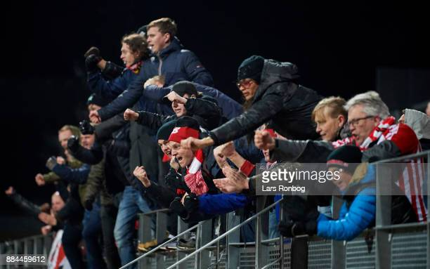 Fans of AaB Aalborg celebrate after the Danish Alka Superliga match between Lyngby BK and AaB Aalborg at Lyngby Stadion on December 2 2017 in Lyngby...