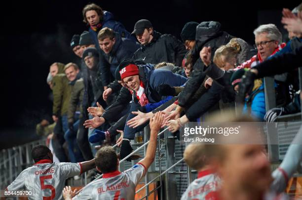 Fans of AaB Aalborg celebrate with the players after the Danish Alka Superliga match between Lyngby BK and AaB Aalborg at Lyngby Stadion on December...