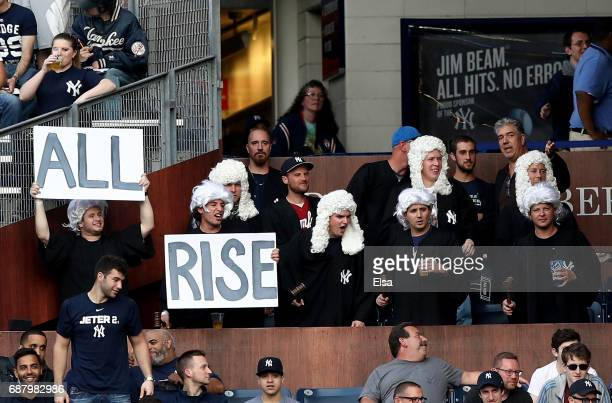 Fans of Aaron Judge of the New York Yankees cheer in the second inning against the Kansas City Royals on May 24 2017 at Yankee Stadium in the Bronx...