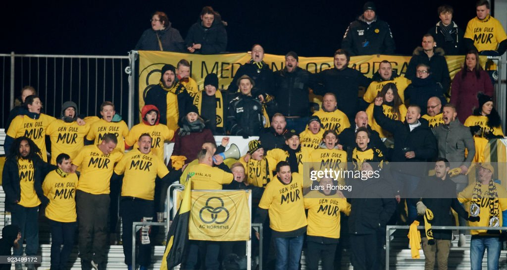 Fans of AC Horsens cheer during the Danish Alka Superliga match between Randers FC and Hobro IK at BioNutria Park on February 18, 2018 in Randers, Denmark.