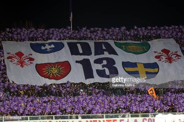 Fans of ACF Fiorentina cheer cheer team during the Coppa Italia match between ACF Fiorentina and Atalanta BC on February 27 2019 in Florence Italy