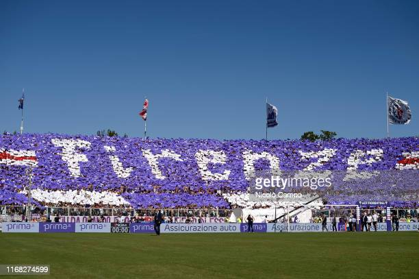 Fans of ACF Fiorentina show their support prior to the Serie A football match between ACF Fiorentina and Juventus FC The match ended in a 00 tie