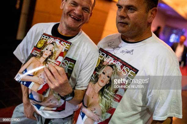 Fans of adult film star Stephanie Clifford AKA Stormy Daniels shows off their signed shirts and magazine outside the Penthouse Club in Philadelphia...