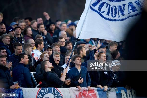 Fans of AGF Aarhus cheer during the Danish Alka Superliga match between FC Helsingor and AGF Aarhus at Helsingor Stadion on April 17, 2018 in...