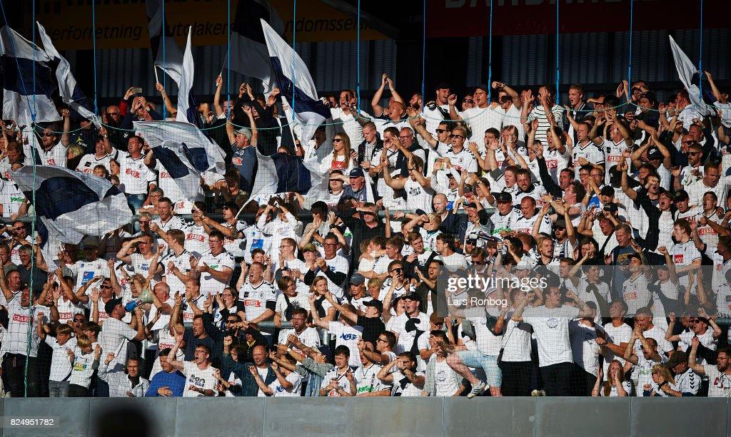 Fans of AGF Aarhus cheer during the Danish Alka Superliga match between Silkeborg IF and AGF Aarhus at Jysk Park on July 31, 2017 in Silkeborg, Denmark.