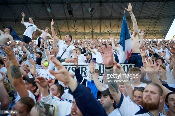 Fans of AGF Arhus celebrate after the Danish Alka Superliga match between OB Odense and AGF Arhus at EWII Park on May 13 2018 in Odense Denmark