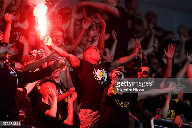 Fans of AIK burning bengals during the allsvenskan match between Hammarby IF and AIK at Tele2 Arena on July 24 2016 in Stockholm Sweden