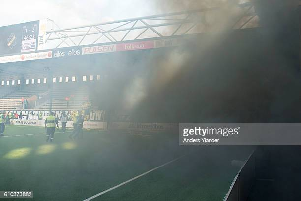 Fans of AIK burning flairs during the Allsvenskan match between IF Elfsborg and AIK at Boras Arena on September 25 2016 in Boras Sweden
