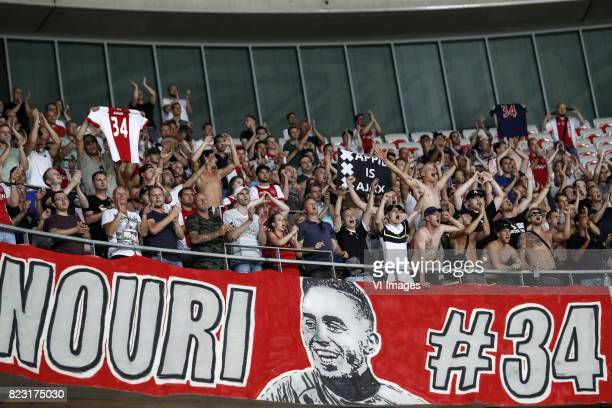 fans of Ajax singing for Abdelhak Nouri of Ajax during the UEFA Champions League third round qualifying first leg match between OGC Nice and Ajax...