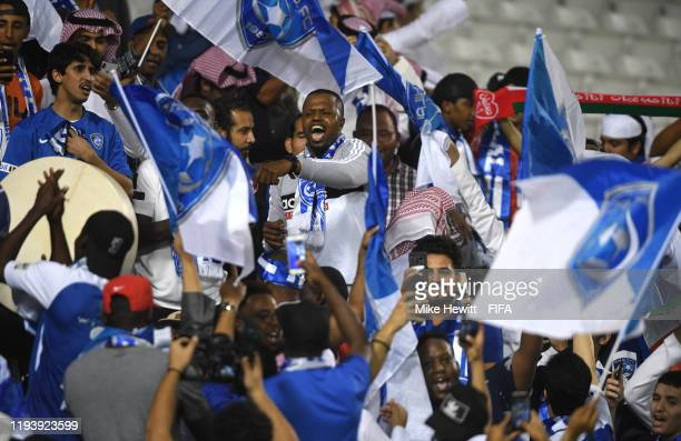 Fans of Al Hilal SFC celebrate following their team's victory in the FIFA Club World Cup 2nd round match between Al Hilal and Esperance Sportive de...