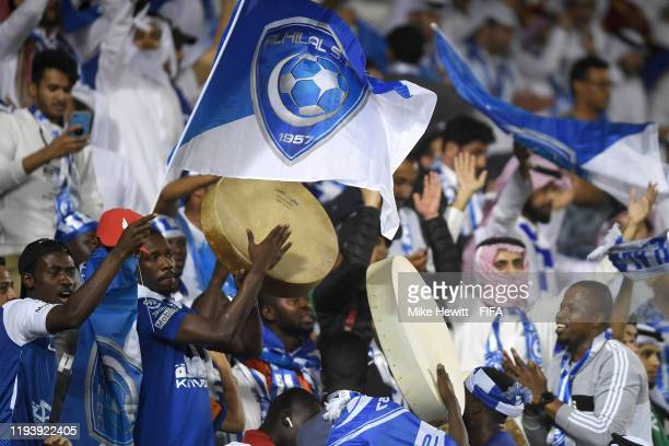 Fans of Al Hilal SFC show their support during the FIFA Club World Cup 2nd round match between Al Hilal and Esperance Sportive de Tunis at Jassim Bin...