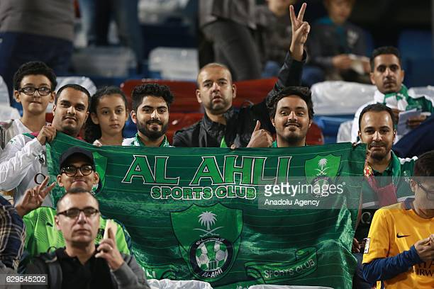 Fans of Al-Ahli Saudi show their support during a friendly soccer match between Al-Ahli Saudi and Barcelona at Al-Gharrafa Stadium in Doha, Qatar on...