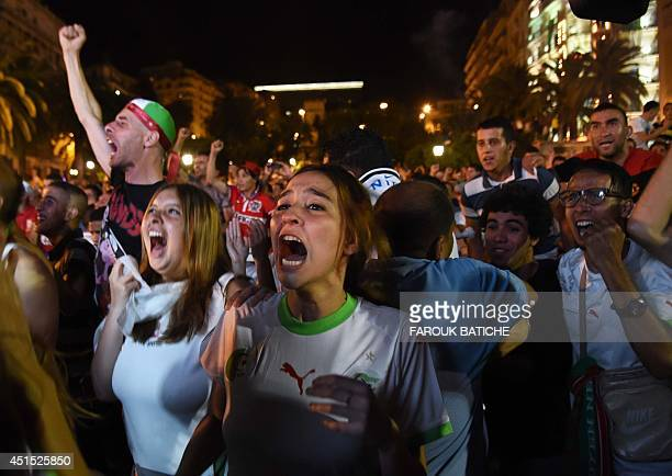 Fans of Alergia react during a public screening June 30 2014 in Algiers of Algeria's 2014 FIFA World Cup match against Germany in Brazil Extratime...