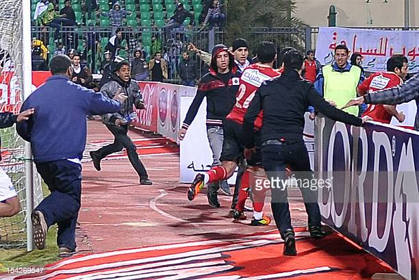 Fans of AlMasry team run after players of the AlAhly team during riots that erupted after the football match between the two teams in Port Said 220...