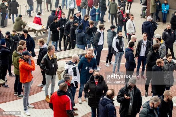 Fans of Almere City FC are seen participating in a Fieldlab pilot with fans in the stadium ahead of Almere City FC v SC Cambuur on February 28, 2021...