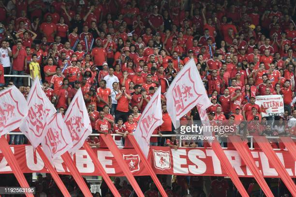 Fans of America cheer for their team during the second leg final match of the Torneo Clausura Liga Aguila 2019 between America de Cali and Junior at...