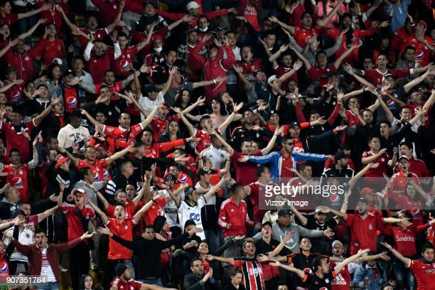 Fans of America de Cali cheer during the friendly match between Millonarios and America de Cali as par of the Torneo Fox Sports 2018 at Nemesio...