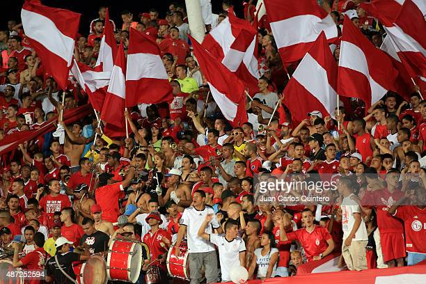 Fans of America de Cali cheer for their team during a match between America de Cali and Barranquilla FC as part of 9th round of second leg of Torneo...