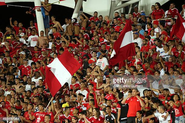 Fans of America de Cali cheer for their team during a match between America de Cali and Llaneros FC as part of round 15 of second leg of Torneo...
