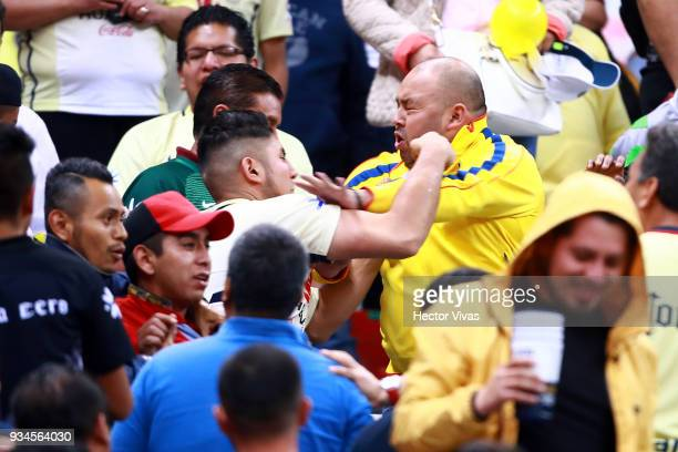 Fans of America fight during the 12th round match between America and Toluca as part of the Torneo Clausura 2018 Liga MX at Azteca Stadium on March...