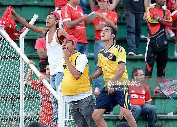 Fans of America protest against the referees after a match between America de Cali and Llaneros FC as part of Torneo Postobon 2014 II at Manuel Calle...