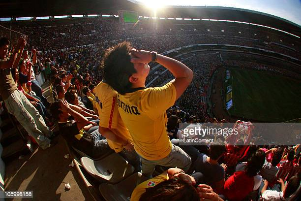 Fans of America react during a Mexican league Apertura 2010 soccer match between Aguilas Del America and Chivas Guadalajara at the Azteca Stadium on...