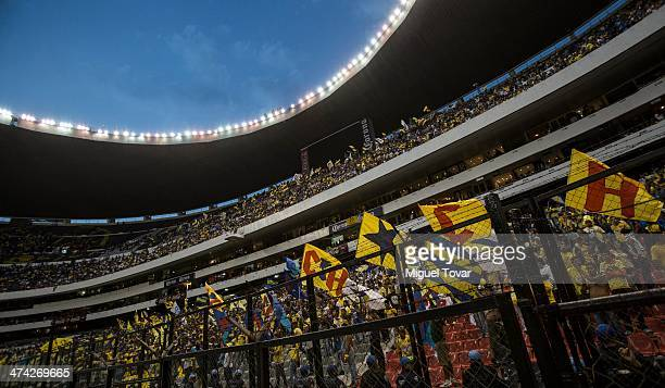 Fans of America sing during a match between America and Pumas UNAM as part of the Clausura 2014 Liga MX at Azteca Stadium on February 22 2014 in...