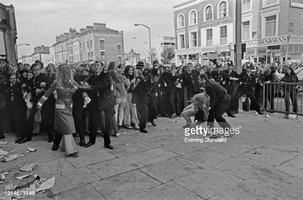 Fans of American vocal group The Osmonds tussle with the police outside the Rainbow Theatre in Finsbury Park, London, UK, 22nd September 1973.