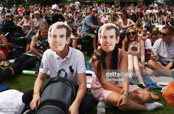 Fans of Andy Murray gather on 'Murray Mount' to watch the Gentlemen's Singles first round match between Andy Murray of Great Britain and David Goffin...