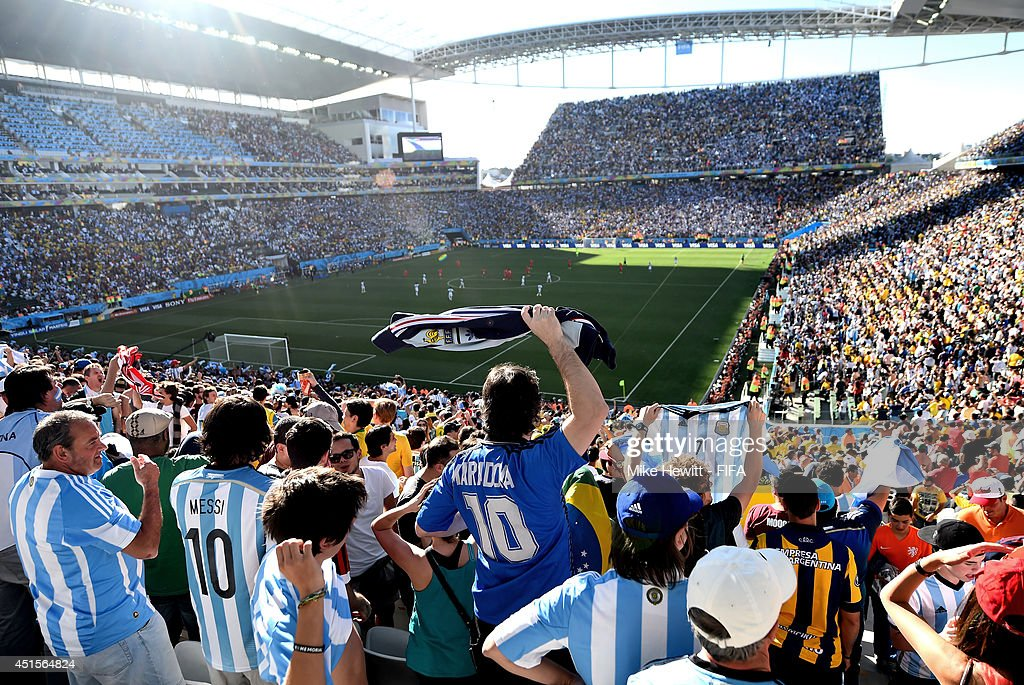 Fans of Argentina celebrate after Angel di Maria of Argentina scores in extra time during the 2014 FIFA World Cup Brazil Round of 16 match between Argentina and Switzerland at Arena de Sao Paulo on July 1, 2014 in Sao Paulo, Brazil.