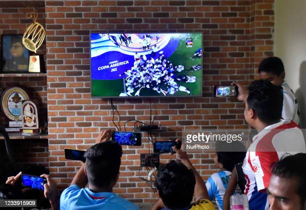 Fans of Argentina celebrate after the national team won the Copa America football tournament final match against Brazil in Kolkata, India, 11 July,...
