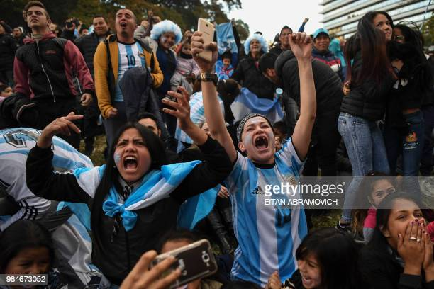 Fans of Argentina celebrate as they watch the FIFA World Cup match between Argentina and Nigeria on a large screen at San Martin square in Buenos...