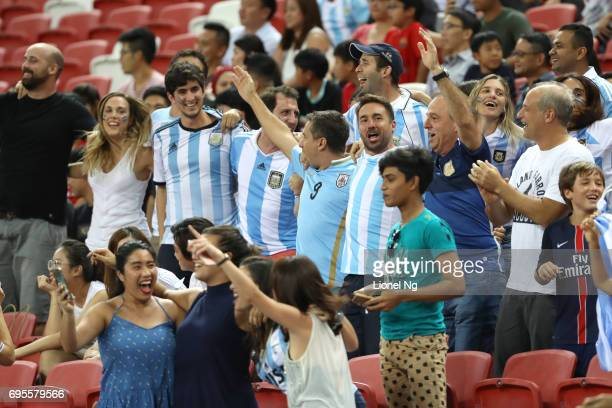 Fans of Argentina celebrate during the international friendly match between Argentina and Singapore at National Stadium on June 13 2017 in Singapore