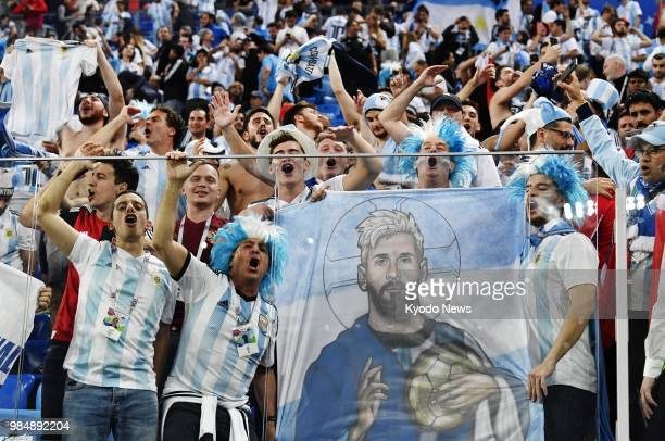 Fans of Argentina celebrate the team's 21 win against Nigeria in World Cup Group D in St Petersburg Russia on June 26 to reach the knockout stage...