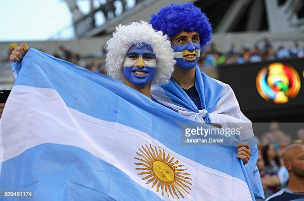 Fans of Argentina cheer before a match against Panama in the 2016 Copa America Centenario at Soldier Field on June 10 2016 in Chicago Illinois...