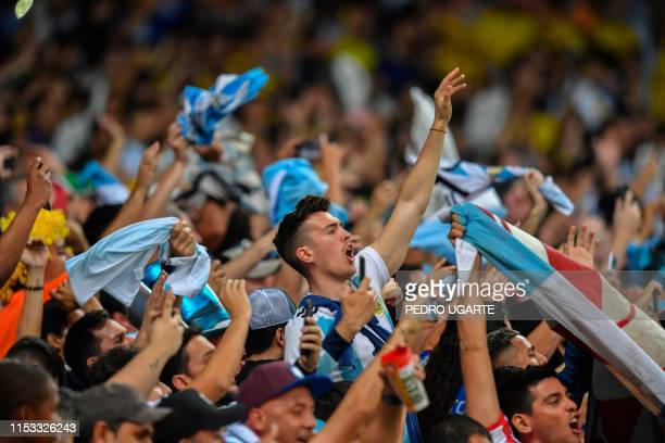 Fans of Argentina cheer before the start of the Copa America football tournament semifinal match against Brazil at the Mineirao Stadium in Belo...
