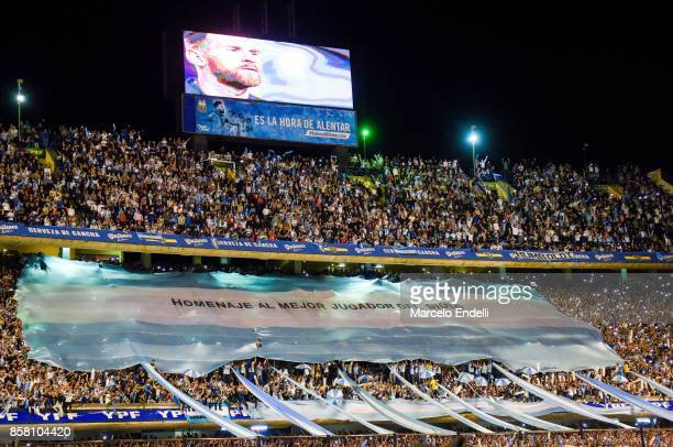 Fans of Argentina cheer for their team during a match between Argentina and Peru as part of FIFA 2018 World Cup Qualifiers at Estadio Alberto J...