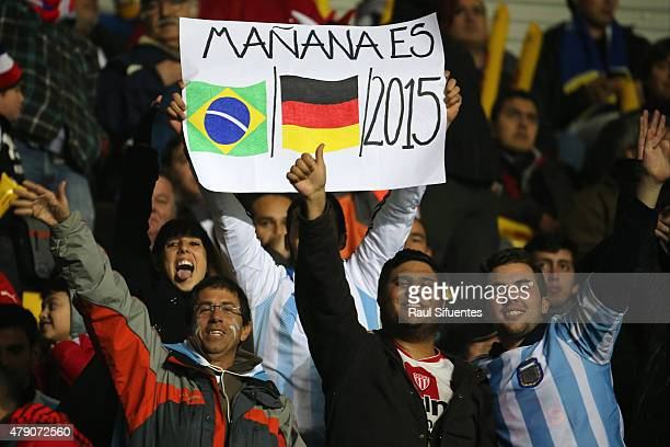 Fans of Argentina display a banner refering the victory 71 of Germany over Brazil at FIFA 2014 World Cup Brazil during the 2015 Copa America Chile...