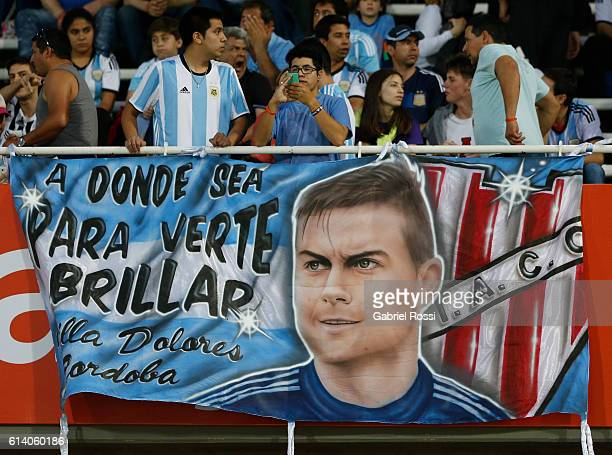 Fans of Argentina display a flag in support of Paulo Dybala of Argentina before a match between Argentina and Paraguay as part of FIFA 2018 World Cup...