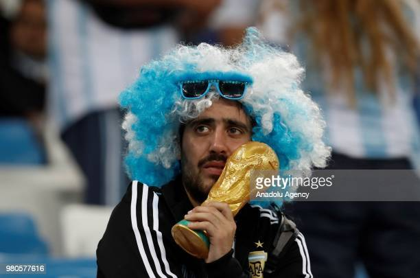 Fans of Argentina react after their national team lost the 2018 FIFA World Cup Russia Group D match against Croatia at Nizhny Novgorod Stadium in...
